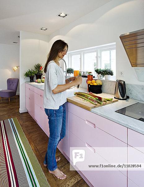 Scandinavia  Sweden  woman preparing food in kitchen