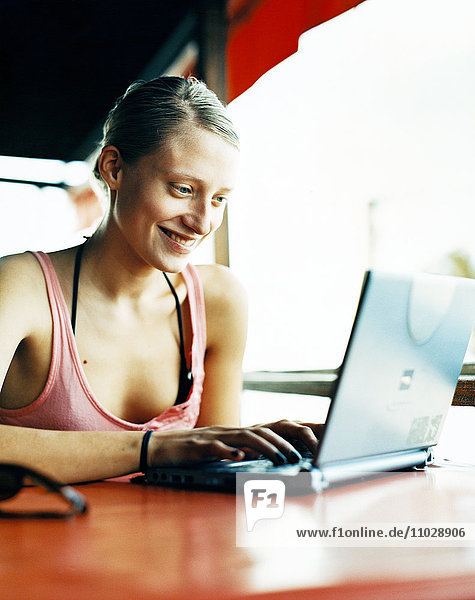 A woman with laptop.