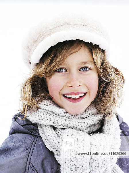 A boy dressed in winter clothes  portrait.