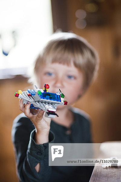 Boy playing Lego spaceship