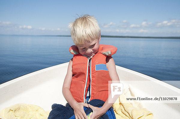 Smiling boy on boat