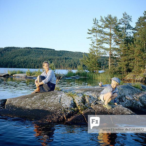 Woman wit son at lake