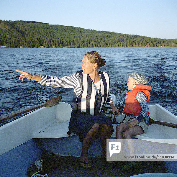 Mother with son on boat