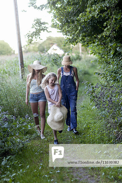 Mother with two daughters walking