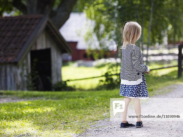 Girl on graveled road