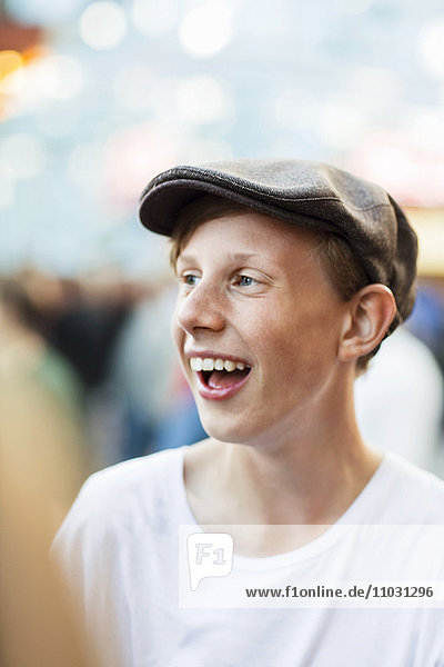 Teenage boy wearing cap laughing