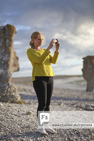 Woman taking pictures  Faro  Gotland  Sweden