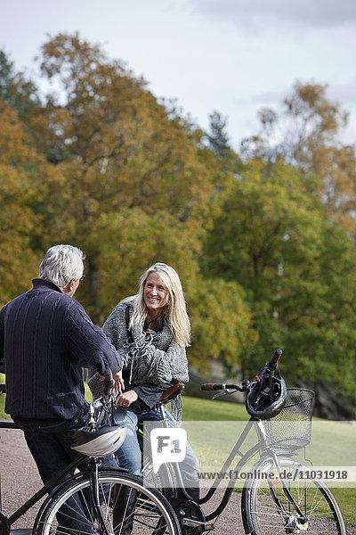 Senior couple cycling  Delsjon  Gothenburg  Sweden