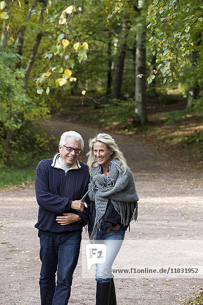 Senior couple walking through forest  Delsjon  Gothenburg  Sweden