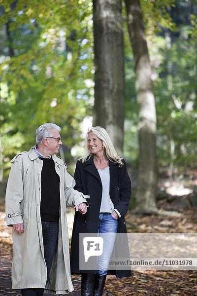 Senior couple walking through forest  Gothenburg  Sweden