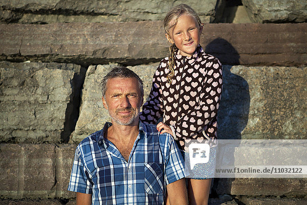 Outdoor portrait of father and daughter