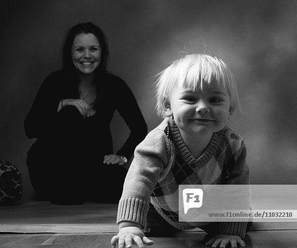 Studio portrait of toddler and mother