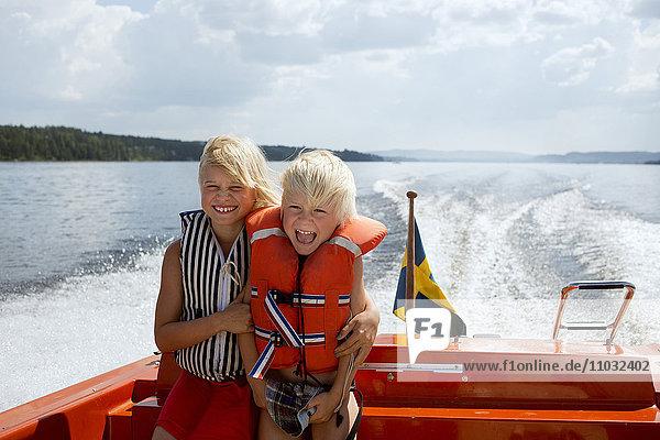 Brother and sister on boat  Siljan  Dalarna  Sweden