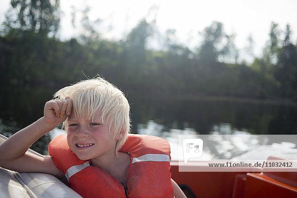 Boy on boat  Siljan  Dalarna  Sweden