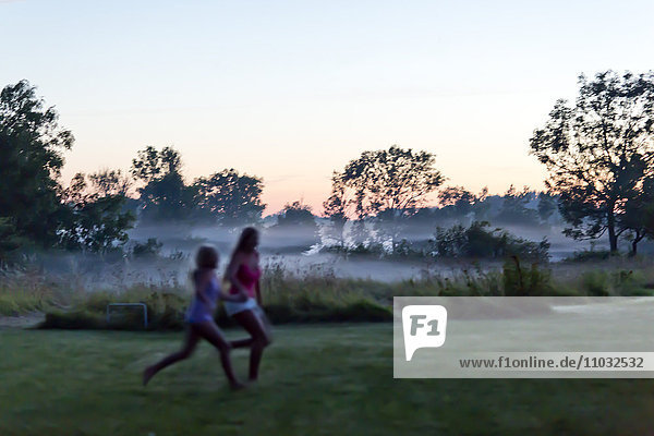 Girls running at evening  Oland  Sweden