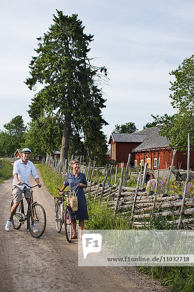 Mature couple cycling  Sweden