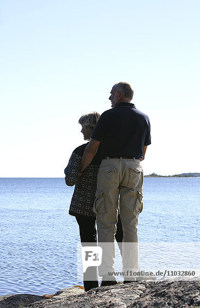 A senior couple looking at the ocean.