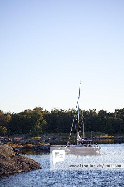 Sailing boat moored on sea