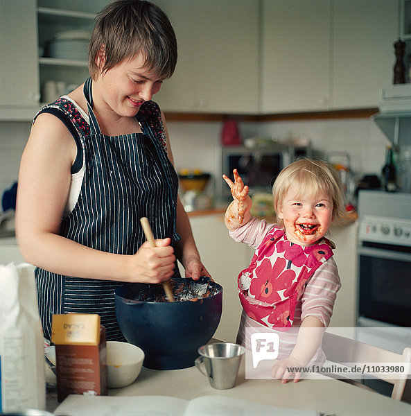 Mother and child baking.