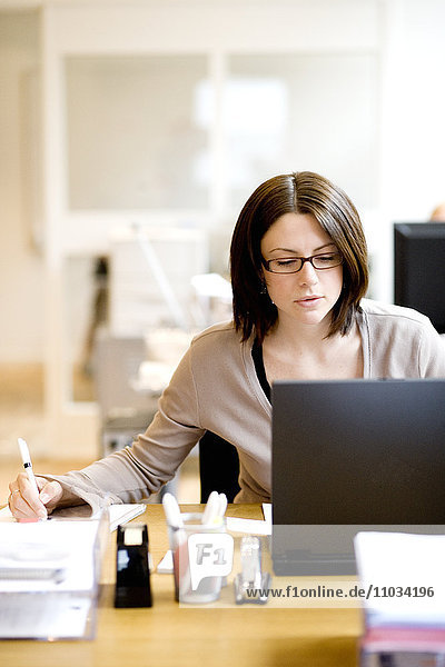 A woman working on a computer.