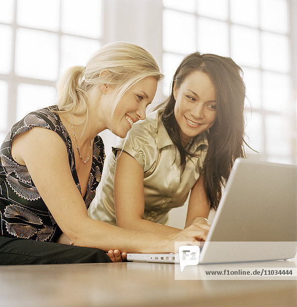 Two women with a laptop.