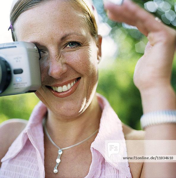 Woman taking a photograph.