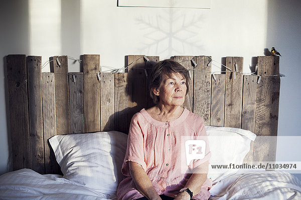 Senior woman sitting in bed