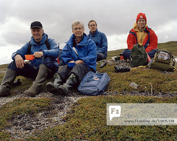 Four hikers resting  Ostersund  Sweden.