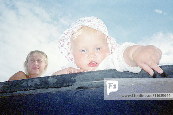 Mother and baby in a boat  Sweden.