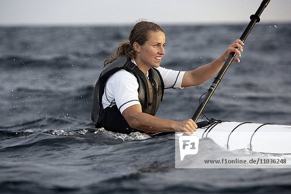 A woman canoeing  Sweden.