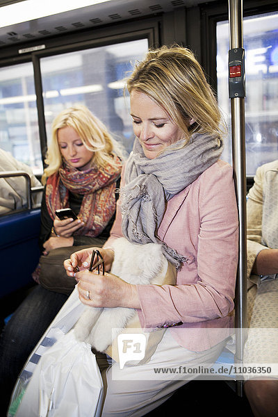 Mother and daughter in bus
