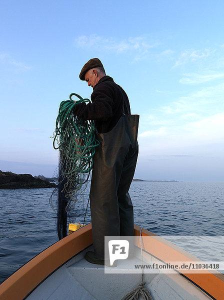 Fisherman drawing nets,  Sweden.