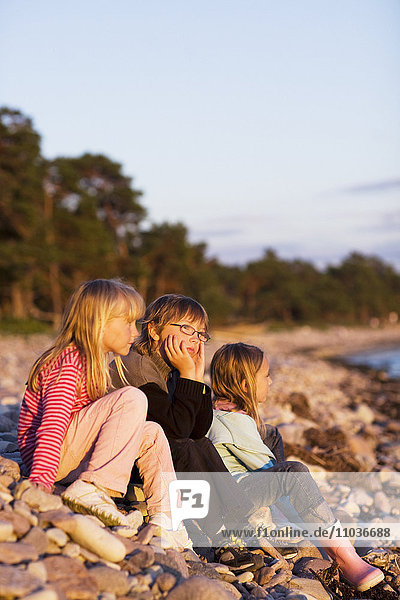 Three friends by the water  Sweden.