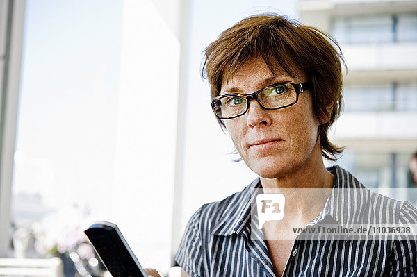 Portrait of a woman using a mobile phone  Sweden.