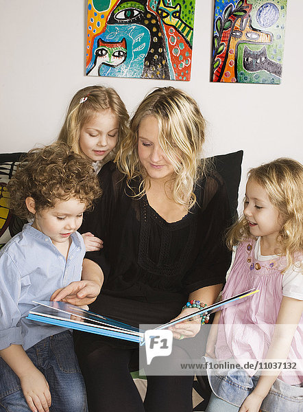 A mother reading to her children  Sweden.