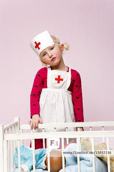 Girl playing a nurse.