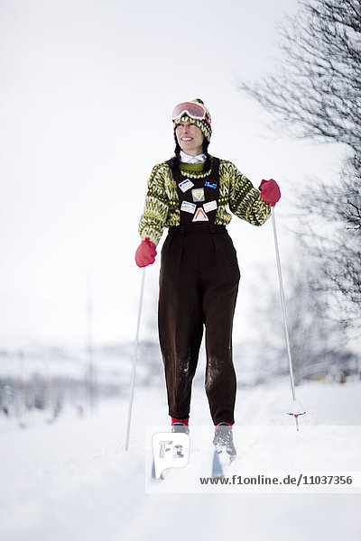 A woman skiing  Sweden.