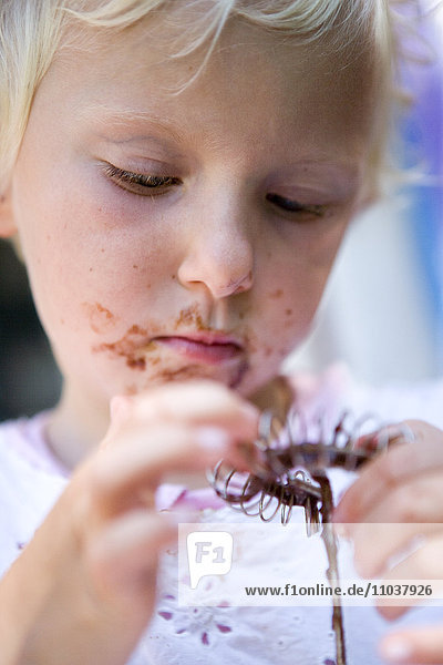 Girl with chocolate mixture in her face  Sweden.