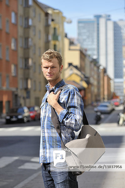 Young man walking on a street  Sweden.