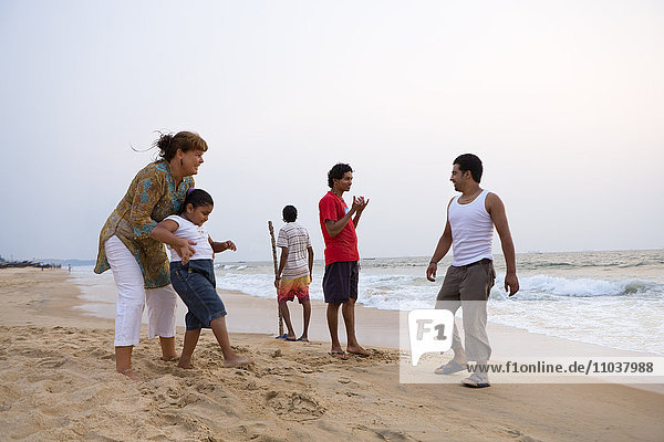 People on a beach  India.