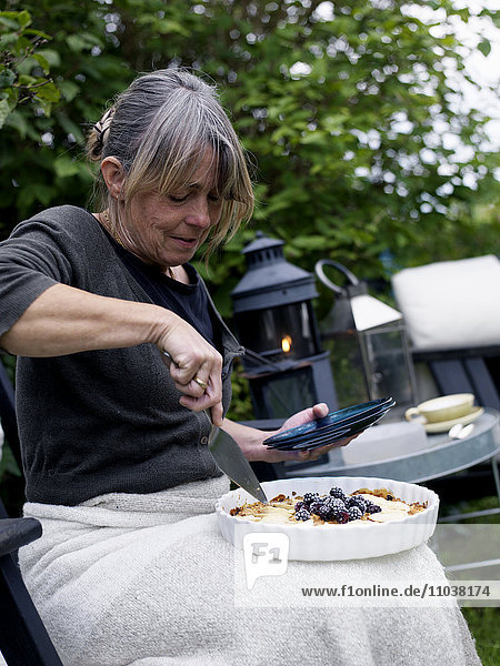 Woman holding an apple-pie  Sweden. Woman holding an apple-pie, Sweden.