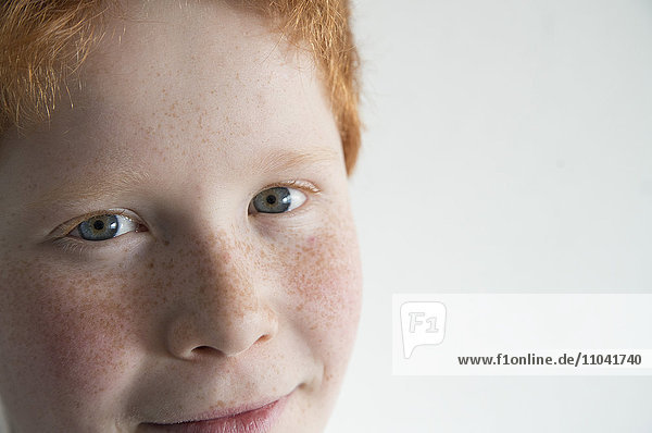 Boy with red hair and freckles  close-up portrait