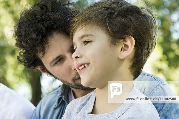 Little boy with father outdoors