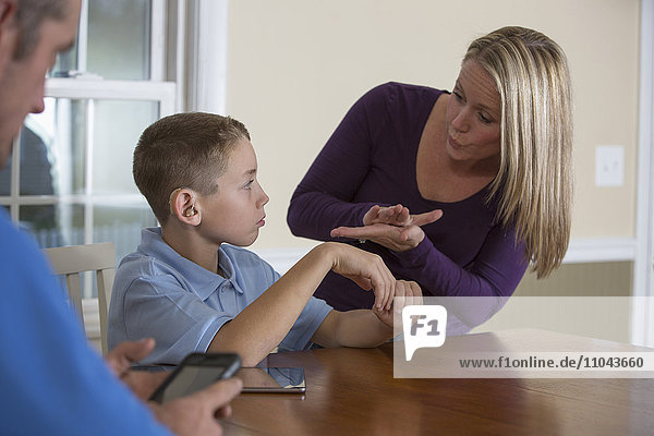 Caucasian mother signing with deaf son