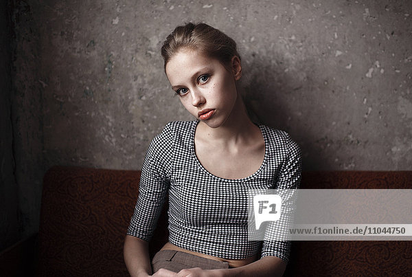 Caucasian woman sitting indoors
