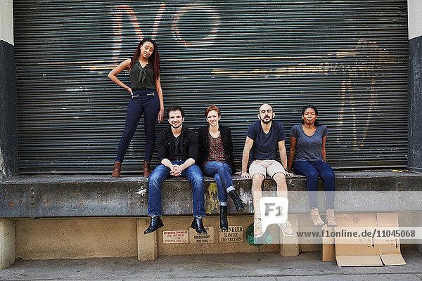 Friends posing on loading dock