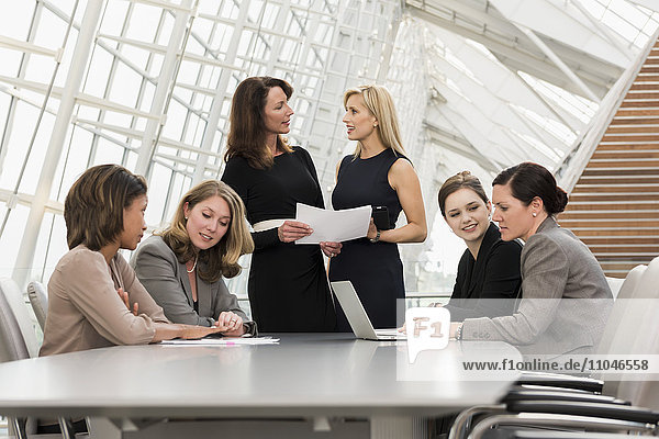 Busy businesswomen meeting in conference room