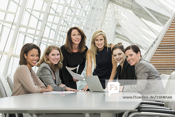 Businesswomen posing in conference room