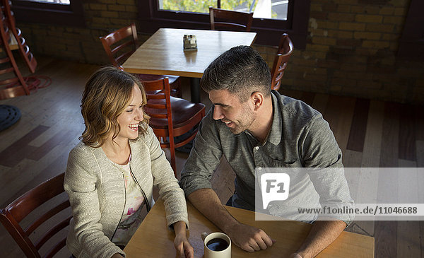 Caucasian couple drinking coffee in cafe