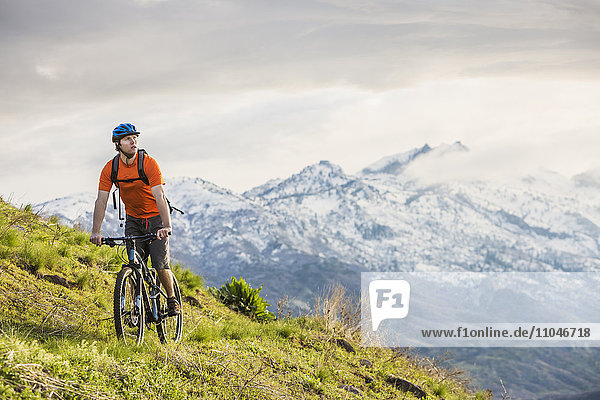 Caucasian man riding mountain bike
